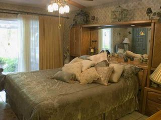 McAllen house photo - This cozy bedroom has a mirrored wall and direct pool access.