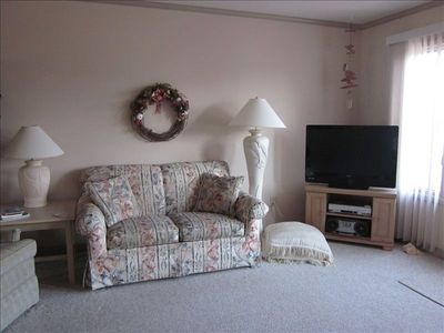 Loveseat in main room and large screen cable TV