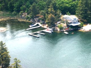 Our cottage is protected in cove with plenty of deep water dock and swimming. - Alexandria Bay cottage vacation rental photo