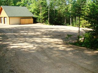 Crandon cabin photo - Very large parking space for vehicles, trailers, and RV's.