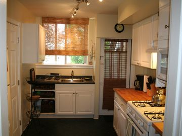 kitchen- full sized refrigerator on the left out of view.