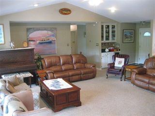 Hot Springs Village house photo - Livingroom with piano, wet bar and lazyboy couches