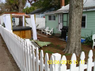 Back of house. Hot tub. Grill - Tybee Island cottage vacation rental photo