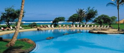 Relax at the resort hotel's or Kauai Beach Villas' pools and spas FREE of charge