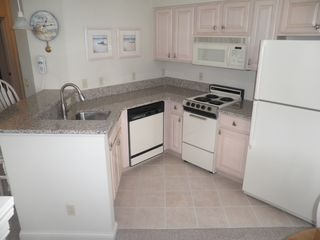 Manistee condo photo - Fully Equipped Kitchen with Granite Countertops