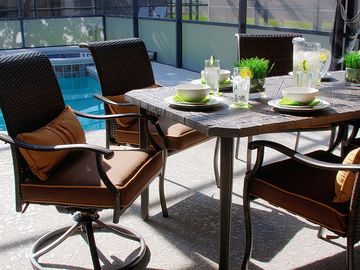 Comfortable furniture for eating poolside.