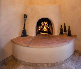 Santa Fe house photo - Warm up by the traditional Kiva fireplace!