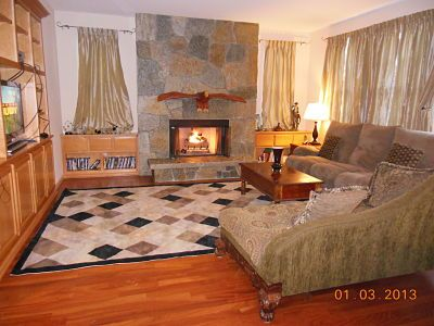 Family room with stone fireplace and Golden Eagle mantle also HDTV.