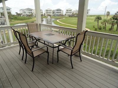 lower deck w/ outdoor dining + 2 rocker chairs