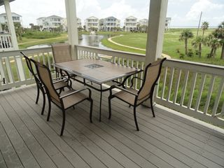 Galveston house photo - lower deck w/ outdoor dining + 2 rocker chairs