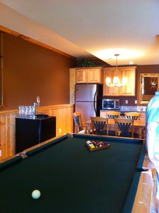 Lower level with pool table and mini-kitchen.