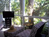Tropical bungalow steps from the baby powder sand of Siesta Beach and Village