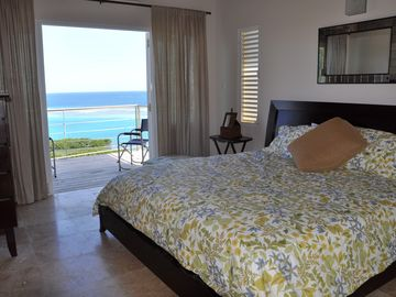 One of two masterbedroom suites, both with ocean and garden views