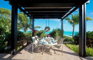 Providenciales - Provo villa photo - Outdoor dining. Hanging sculpture by Jesus Moroles