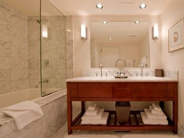 Lavish Marble Bathroom - Lavish Bathroom with deep tub to relax in.