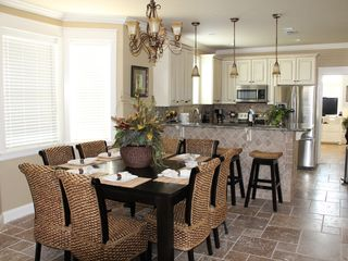 Crystal Beach house photo - Dining area - seating for 8 at table, 4 more at counter