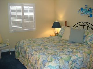 Surfside Beach condo photo - Comfortable master bedroom with king size bed