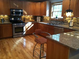 Thornton house photo - contemporary well equipped kitchen with granite countertop and s/s appliances