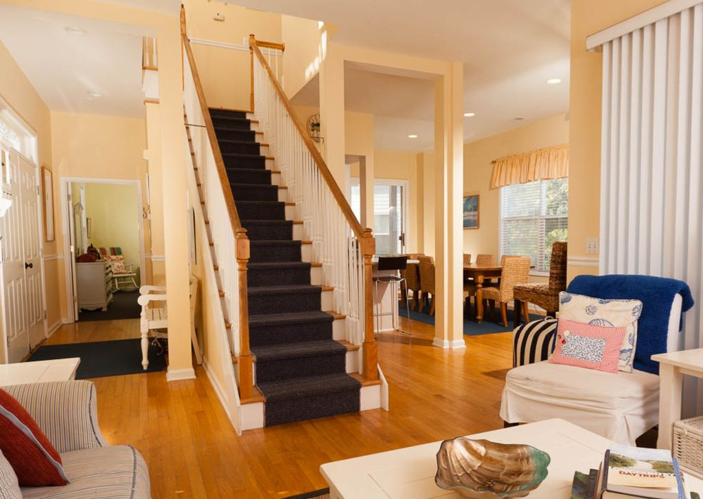 Stair case to second floor which has 3 bedrooms and 2 baths