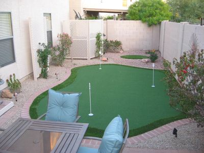 Back yard area with putting green.
