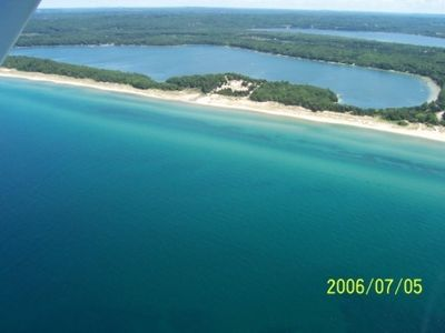 Frankfort cabin rental - Lower Herring Lake and Lake Michigan Beach, stream visible in the center.
