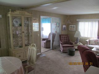 New Port Richey mobile home photo - Living Room, Dining Room, and Entrance to Florida Room