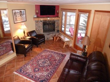 Crested Butte townhome rental - Bright, sunny living room, cozy fireplace and deck with breathtaking views!