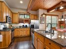 Full stocked kitchen with microwave, gas oven, large granite island with sink.