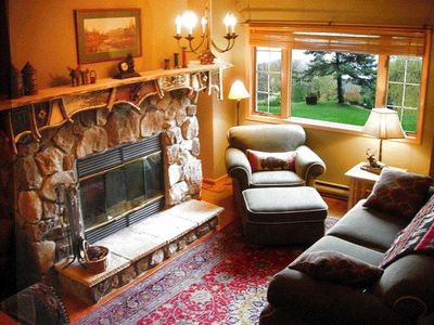 Living Room with rustic Adirondack fireplace