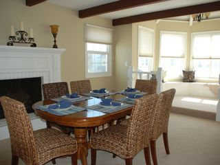 Oxnard house photo - Dining room with fireplace and built-in rotunda seating area.