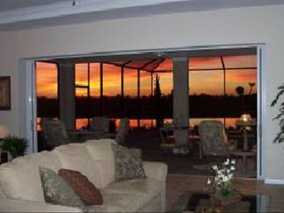 Living Room open to the Lanai facing a typical evening sunset