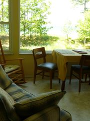 Manistee house photo - Play a game & watch the water with twin sofabed to sleep on & enjoy the breeze.