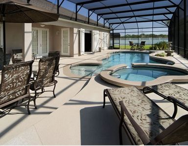 Spacious pool deck with pool, spa & privacy fence