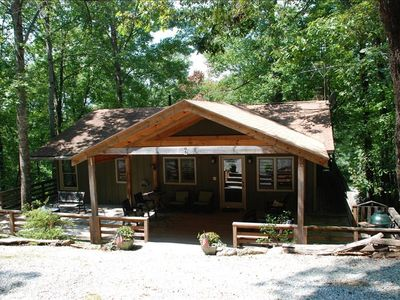 Great wooded cabin with wrap-around porches on both levels.