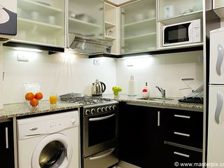 Palermo apartment photo - Fully furnished kitchen with fridge, freezer, microwave, washing machine, stove.