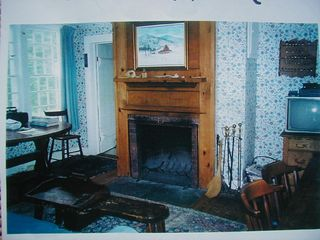 Dorset house photo - Sitting room with fireplace