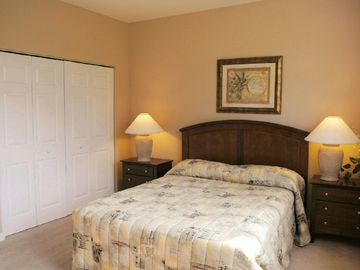 Queen bedroom with cable TV and conservation view
