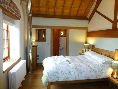 STABLES: Comfy double bed, ensuite shower, exposed beams & features, great view