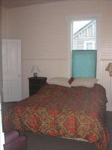 Bedroom with queen bed.