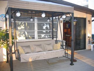 Englewood house photo - Canopy swing lounger and deck