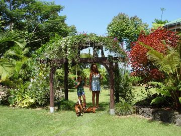 Hilo house rental - Flower covered gazebo leading to ponds, garden and view of the Hilo coastline.