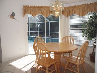 Briarwood Naples house photo - kitchen table overlooking the pool area
