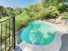Pool Area - Private heated pool with gorgeous views across the tree-filled grounds.