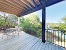 Lower-level Deck - The lower-level deck provides a perfect place for morning coffee at the table for 4.