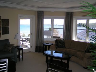 Living room w/angled view of Grand Traverse Bay. Beautiful!
