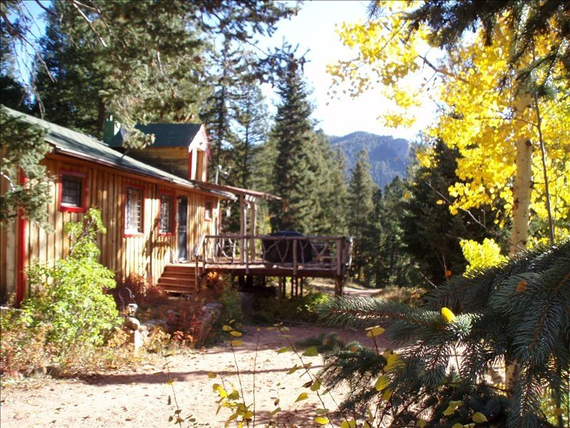 Old stage cabin deck with grill and outdoor seating for Cabine colorado vrbo