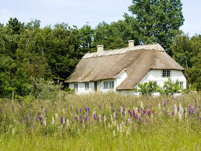Thatched farmhouse idyll on cliffs