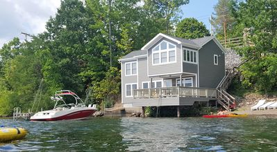 Water's Edge lakefront.  Dock accommodates a 23' boat.  Swim raft, dock w/ladder
