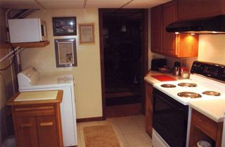 Interlochen studio photo - Fully equipped kitchen, including refrigerator and freezer.