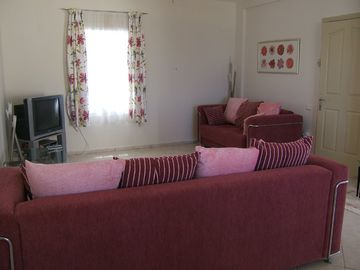 The open plan living room with TV and DVD player